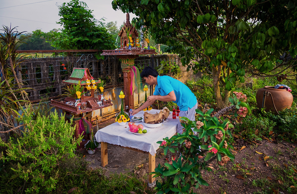 A table is prepared while feeding The Spirits in Nakhon Nayok, Thailand PHOTO BY LEE CRAKER