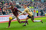 Uche Ikpeazu (#19) of Heart of Midlothian FC shields the ball from Dean Campbell (#24) of Aberdeen FC during the Ladbrokes Scottish Premiership match between Heart of Midlothian FC and Aberdeen FC at Tynecastle Stadium, Edinburgh, Scotland on 29 December 2019.