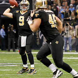 January 7, 2012; New Orleans, LA, USA; New Orleans Saints quarterback Drew Brees (9) passes to fullback Jed Collins (45) against the Detroit Lions during the 2011 NFC wild card playoff game at the Mercedes-Benz Superdome. Mandatory Credit: Derick E. Hingle-US PRESSWIRE