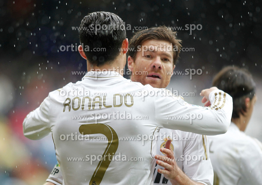 29.04.2012, Santiago Bernabeu Stadion, Madrid, ESP, Primera Division, Real Madrid vs FC Sevilla, 36. Spieltag, im Bild Real Madrid's Cristiano Ronaldo celebrates with Xabi Alonso the football match of spanish 'primera divison' league, 36th round, between Real Madrid and FC Sevilla at Santiago Bernabeu stadium, Madrid, Spain on 2012/04/29. EXPA Pictures © 2012, PhotoCredit: EXPA/ Alterphotos/ Alvaro Hernandez..***** ATTENTION - OUT OF ESP and SUI *****
