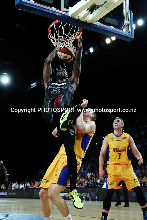 Ekene Ibekwe of the Breakers with a dunk. 2014/15 ANBL, SkyCity Breakers vs Adelaide 36ers, Vector Arena, Auckland, New Zealand. Thursday 12 February 2015. Photo: Anthony Au-Yeung / www.photosport.co.nz
