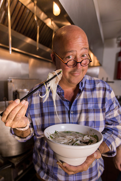 ANDREW ZIMMERN, CHEF, TV PERSONALITY, WRITER, ON LOCATION WITH A BOWL OF PHO.