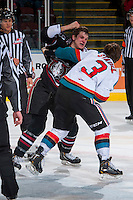KELOWNA, CANADA -FEBRUARY 5: Riley Stadel #3 of the Kelowna Rockets drops the gloves with Conner Bleackley C #9 of the Red Deer Rebels during the second period on February 5, 2014 at Prospera Place in Kelowna, British Columbia, Canada.   (Photo by Marissa Baecker/Getty Images)  *** Local Caption *** Riley Stadel; Conner Bleackley;