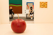 """New York, NY - May 3, 2019. Spectators pass Claude Lalanne's painted bronze """"Pomme de Jardin"""" in the Kasmin Gallery at the Frieze Art Fair on New York City's Randalls Island."""