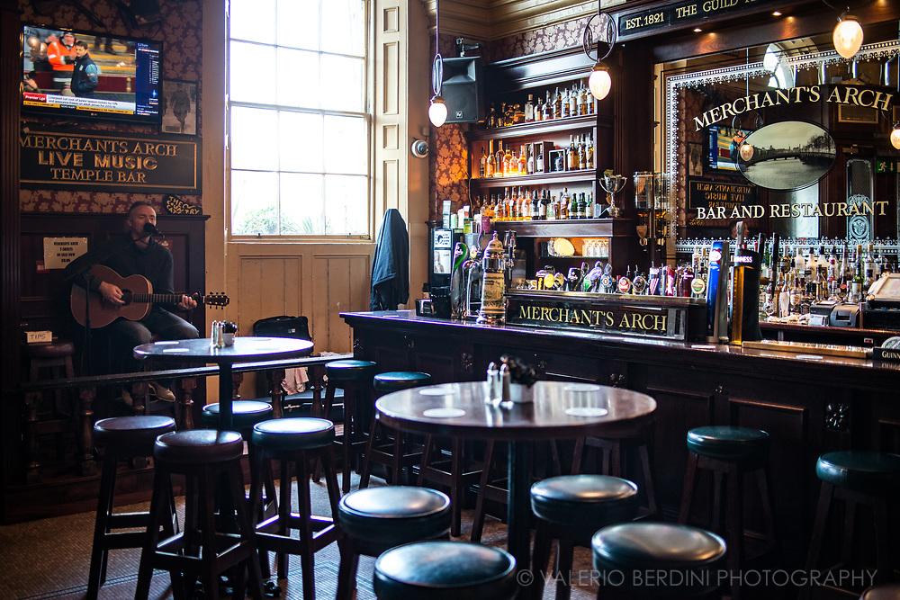 A crooner sings songs in an empty pub in Temple Bar, in Dublin.
