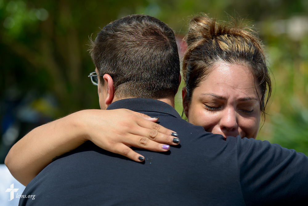Evelyn Cardenas, a staff member at Amigos en Cristo Lutheran Mission, tries to hold back tears as she hugs in thankfulness the Rev. Dr. Ross Johnson, director of LCMS Disaster Response, following a visit to her hurricane-damaged home on Wednesday, Sept. 13, 2017, in Bonita Springs, Fla. LCMS Communications/Erik M. Lunsford