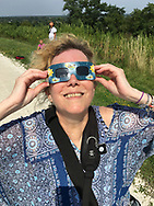 Merrick, New York, USA. August 11, 2017. Partial Solar Eclipse, 70% at maximum point, viewed from Norman J Levy Park and Preserve in South Merrick, on the South Shore of Long Island, New York.