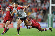 Robbie Fruean crashes through the tackle of Will Genia ~ Super 15 rugby (Round 15) - Reds v Crusaders played at Suncorp Stadium, Brisbane, Australia on Sunday 29th May 2011 ~ Photo : Steven Hight (AURA Images) / Photosport
