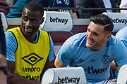 Pedro Obiang (West Ham) & Lucas Perez (West Ham) on the bench ahead of the Premier League match between West Ham United and Leicester City at the London Stadium, London, England on 20 April 2019.