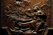 Angels at the tomb, detail from the Assumption of the Virgin, bas-relief on the sculpted wooden choir stalls, of which 78 of 114 remain, 52 upper and 26 lower stalls, carved by Jean Noel and Louis Marteau after drawings by Rene Charpentier and Jean Dugoulon, early 18th century, in the choir of the Cathedrale Notre-Dame de Paris, or Notre-Dame cathedral, built 1163-1345 in French Gothic style, on the Ile de la Cite in the 4th arrondissement of Paris, France. The high backs of the stalls are decorated with bas-reliefs and separated by trumeaux decorated with foliage and instruments of the Passion. Photographed on 17th December 2018 by Manuel Cohen