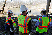 Jason Paige, superintendent of Kickapoo Empire LLC (center), shows contractors and media significant parts of the Trinity River corridor as Kickapoo Empire LLC and DDM Construction Corporation begin moving dirt in the upper chain of wetlands in the Trinity River near Cedar Crest Blvd. in Dallas, Texas, on January 31, 2013.  (Stan Olszewski/The Dallas Morning News)