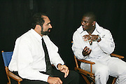 ONTARIO - JULY 23:  Hall of Fame running back Franco Harris (shirt and tie) of the four-time Super Bowl Champion Pittsburgh Steelers with running back LaDainian Tomlinson of the San Diego Chargers during a break in the filming of the NFL's 2005 Super Bowl XL television ad campaign in Ontario, California on July 23, 2005. ©Paul Anthony Spinelli *** Local Caption *** LaDainian Tomlinson, Franco Harris