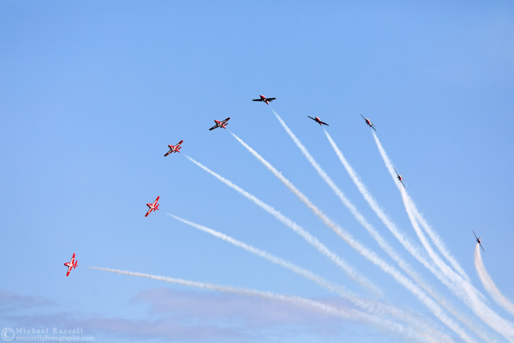 Canadian Forces Snowbirds perform a Maple Split with smoke.  The Snowbirds are also known as the 431 Air Demonstration Squadron and fly the Canadair CT-114 Tutor jet. Photographed during the Canada 150 celebrations in White Rock, British Columbia, Canada.