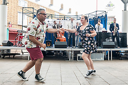 © Licensed to London News Pictures. 28/06/2015. London, UK. Members of the public dancing to Natty Congeroo & The Flames of Rhythm at the Swing East jump 'n' jive jamboree in Chrisp Street Market in London's East End.  Revellers gathered together in vintage clothing to celebrate fifties music and dance, lots and lots of dance. Photo credit : Stephen Chung/LNP