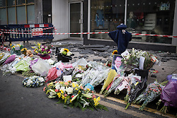 © Licensed to London News Pictures . FILE PICTURE DATED 15/07/2013 . Oldham Street , Manchester , UK .  Flowers and tributes left at the scene on Oldham Street following a fire at Paul 's Hair World on 13th July which claimed the life of fireman Stephen Hunt . Photo credit : Joel Goodman/LNP