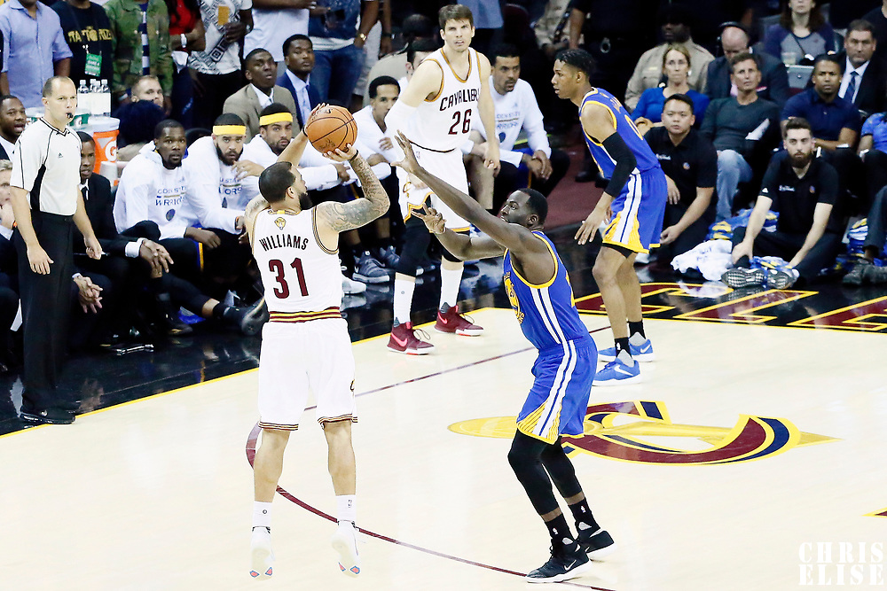09 June 2017: Cleveland Cavaliers guard Deron Williams (31) takes a jump shot over Golden State Warriors forward Draymond Green (23) during the Cleveland Cavaliers 137-11 victory over the Golden State Warriors, in game 4 of the 2017 NBA Finals, at  the Quicken Loans Arena, Cleveland, Ohio, USA.