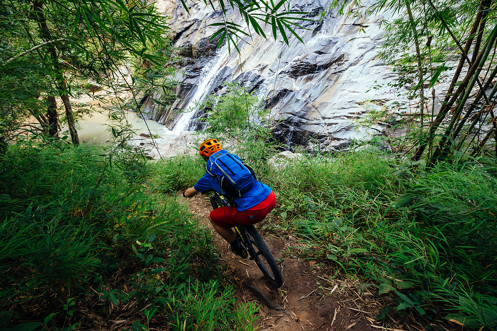 Andrew Whiteford rides the Mae Wang single track trail in the jungle near Chiang Mai, Thailand.