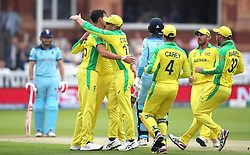 Australia's Mitchell Starc (left) celebrates taking the wicket of England's Joe Root during the ICC Cricket World Cup group stage match at Lord's, London.
