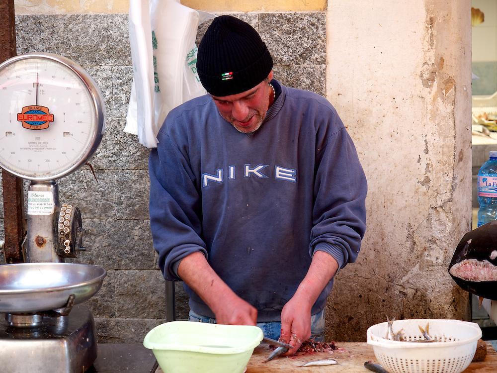 Vendor Cleaning Fish