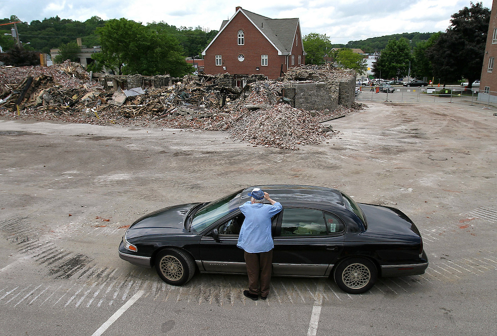Weymouth, MA June 17, 2005 Braintree resident Vincent LoCicero, superintendant of the demolition company removing the church debris, stares out at what once was the Weymouth Sacred Heart Church where he was a parishoner for 33 years.  Today, at the Sacred Heart School Pastor Dan Riley announced to the students, teachers and parishoners at a last day of school assembly that they will rebuild the church.