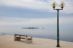 18.03.2011, Porec, CRO, Feature, im Bild eine Parkbank an der Promenade zum Meer neben einer Laterne mit einem Leuchtturm auf einer kleinen insel, EXPA Pictures © 2012, PhotoCredit: EXPA/ Erwin Scheriau