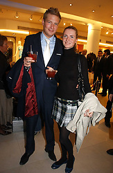 ED GRANT and CHLOE DELEVINGNE at the launch of Roberto Cavalli Vodka held in the International Designer Room, Harrods, Hans Crescent, London on 5th December 2006.<br />