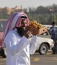 60366646  <br /> A man leaves the worlds biggest date palm market in Buraidah, some 300 km north of Riyadh, capital of Saudi Arabia, Aug. 18, 2013. There are 23 million date palm trees in Saudi Arabia, while the annual output of date palms amount to millions of tons, Sunday, August 18, 2013. <br /> Picture by imago / i-Images<br /> UK ONLY