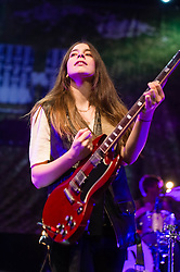 © Licensed to London News Pictures. 09/12/2013. London, UK.   Haim performing live at The Forum. In this pic - Danielle Haim.Haim is an American indie rock band consists of sisters Este Haim (bass/vocals), Danielle Haim (guitar/vocals) and Alana Haim (guitar/vocals/keyboards) with drummer Dash Huttong<br /> <br /> Haim were nominated in the Brand New for 2013 category in the 2013 MTV Music Awards, and won the Sound of 2013 category in the BBC Sound of 2013 awards. <br /> <br /> Photo credit : Richard Isaac/LNP