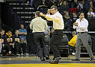 December 8, 2011: Iowa Hawkeyes head coach Tom Brands is pumped up after the 157 pound bout of the NCAA wrestling dual between the Northern Iowa Panthers and the Iowa Hawkeyes at Carver-Hawkeye Arena in Iowa CIty, Iowa on Thursday, December 8, 2011. St. John defeated Bonin 3-1and Iowa defeated Northern Iowa 38-4.