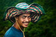 Philippines, Luzon. Portrait of Chris, guiding groups to the Taal volcano.