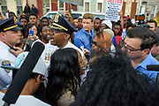 Baltimore, Maryland - April 20, 2015: Baltimore Police Lt. Col. Melvin T. Russell, middle, addresses demonstrators gathered outside the Western District Police Station in Baltimore Monday to protest the death of Freddie Gray.<br /> <br /> <br /> CREDIT: Matt Roth for The New York Times<br /> Assignment ID: 30173608A