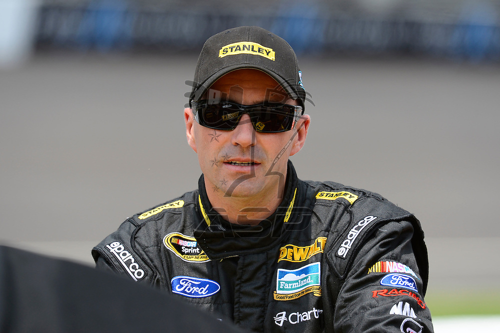 Brooklyn, MI - JUN 16, 2012: Marcos Ambrose (9) during qualifying for the Quicken Loans 400 race at the Michigan International Speedway in Brooklyn, MI.