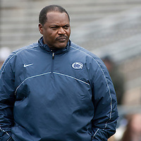 Penn State defensive line coach Larry Johnson paces the sideline before the start of the annual Blue/White game on April 20, 2013 at Beaver Stadium in University Park, PA.