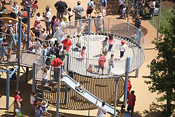 Stock photo of children playing on the playground