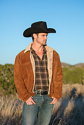cowboy outdoors at sunset