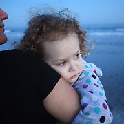 On December 27, 2012 two year old Holly Larue Frizzelle was diagnosed with Acute Lymphoblastic Leukemia. What began as a stomach ache and visit to her regular pediatrician led to a hospital admission, transport to the University of North Carolina Children's Hospital, and more than two years of treatment. Leilani Frizzelle and her daughter Holly Larue Frizzelle, 2, enjoy an unseasonably warm January evening at Wrightsville Beach during Larue's induction phase of treatment for leukemia. During this phase Larue's contact with others is limited due to a compromised immune system.