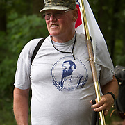Warren Wagner, who grew up in Virginia, but now lives in Gettysburg, carries a Confederate flag, while wearing a Stonewall Jackson t-shirt, prior to the Pickett's Charge Commemorative March, during the Sesquicentennial Anniversary of the Battle of Gettysburg, Pennsylvania on Wednesday, July 3, 2013.  A 22-year veteran of the US Army and graduate of the Virginia Military Institute, Wagner has a descendant who served in the Civil War, while his wife has a descendent who fought for the 9th VA at Gettysburg.  The Battle of Gettysburg lasted from July 1-3, 1863 resulting in over 50,000 soldiers killed, wounded or missing.  John Boal Photography