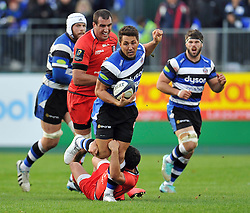 Gavin Henson of Bath Rugby takes on the Toulouse defence - Photo mandatory by-line: Patrick Khachfe/JMP - Mobile: 07966 386802 25/10/2014 - SPORT - RUGBY UNION - Bath - The Recreation Ground - Bath Rugby v Toulouse - European Rugby Champions Cup