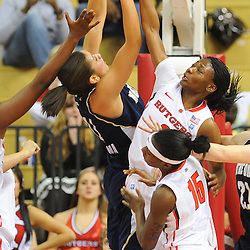 Rutgers Scarlet Knights guard Erica Wheeler (3) blocks a shot by Notre Dame Fighting Irish forward Natalie Achonwa (11) during second half NCAA Big East women's basketball action between Notre Dame and Rutgers at the Louis Brown Athletic Center. Notre Dame defeated Rutgers 71-41.