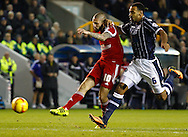 Picture by David Horn/Focus Images Ltd +44 7545 970036<br /> 03/12/2013<br /> Liam Trotter of Millwall (right) is unable to stop the shot from Henri Lansbury of Nottingham Forest during the Sky Bet Championship match at The Den, London.