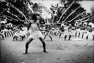 11..Young girl dances in Ati-Atihan Festival, Coron Town.  Ati-Atihan commemorates the.legendary first meeting between the Malayo-Polynesian people and the indigenous Ati Negritos who retreated to the mountains after the arrival of the Malayo-Polynesians, Philippines..