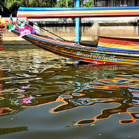 Tourists on Boat Tour through Canals in Bangkok, Thailand <br />