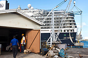 In the shadow of a cruise ship, at the dock in Ocho Rios Jamaica.
