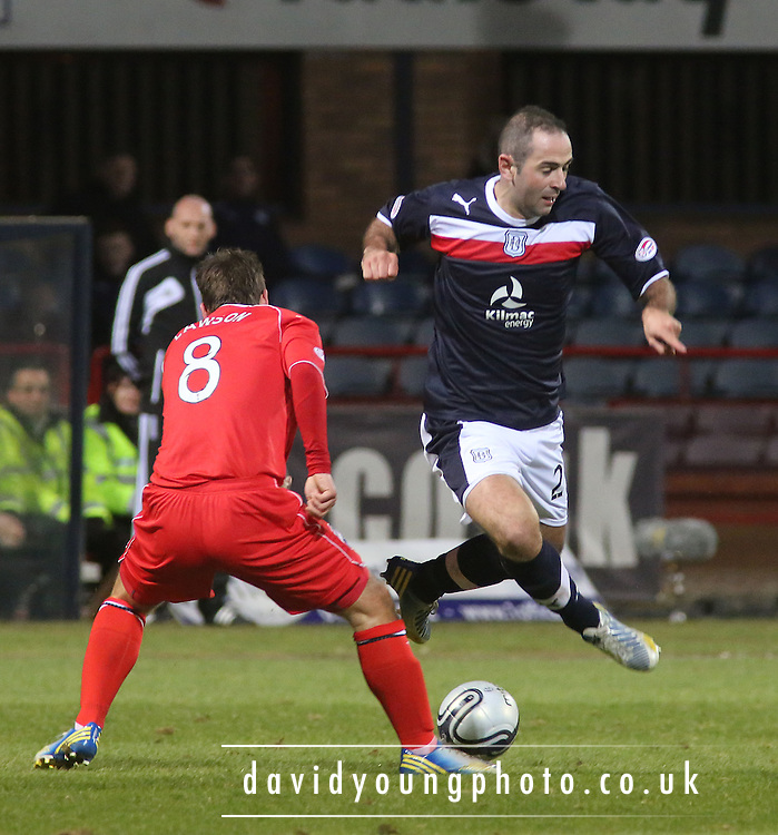 Paul Lawson  tackles Gary Harkins  - Dundee v Ross County, Clydesdale Bank Scottish Premier League at Dens Park .. - © David Young - www.davidyoungphoto.co.uk - email: davidyoungphoto@gmail.com