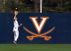 Virginia Cavaliers OF Jarrett Parker (13) grabs a pop fly in the outfield.  The #15 ranked Virginia Cavaliers baseball team defeated the Virginia Tech Hokies 10-1 at the University of Virginia's Davenport Field in Charlottesville, VA on March 28, 2008.