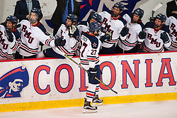 March 11 2016: Robert Morris Colonials forward Zac Lynch (27) celebrates with teammates on the bench after scoring a shorthanded goal during the first period in game one of the Atlantic Hockey quarterfinals series between the Bentley Falcons and the Robert Morris Colonials at the 84 Lumber Arena in Neville Island, Pennsylvania (Photo by Justin Berl)