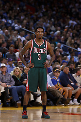 Mar 16, 2012; Oakland, CA, USA; Milwaukee Bucks point guard Brandon Jennings (3) during a stoppage in play against the Golden State Warriors during the third quarter at Oracle Arena. Milwaukee defeated Golden State 120-98. Mandatory Credit: Jason O. Watson-US PRESSWIRE