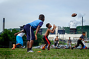 Clairton youth football practice takes place in a field across from the United States Steel Clairton Works coke plant. The Clairton Works, the largest coke manufacturing facility in the United States, is one of the biggest sources of air quality complaints in the region. Making coke is one of the dirtiest processes in making steel.<br />