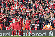 The Liverpool players celebrate scoring their second to take the lead, 2-1 during the Barclays Premier League match between Liverpool and Stoke City at Anfield, Liverpool, England on 10 April 2016. Photo by Mark P Doherty.