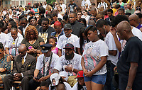 Michael Brown Sr., and other family members at the spot where his son was killed listens at an event to mark the one year anniversary of the killing of son Michael Brown Jr. in Ferguson, Missouri August 9, 2015.  Several hundred people gathered in Ferguson, Missouri, on Sunday to mark the one-year anniversary of the shooting death of an unarmed black teenager by a white police officer that sparked protests and a national debate on race and justice.  REUTERS/Rick Wilking